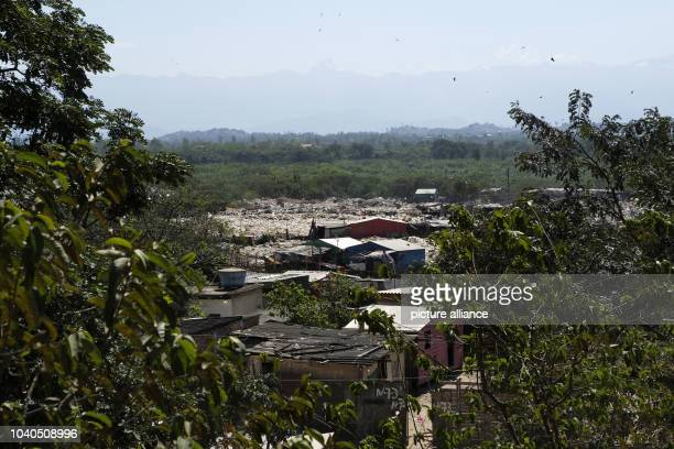 View of a settlement in the dumps of Gramacho in Rio den Janeiro Brazil 13 Augsut 2016 Hundreds of people live in wooden barracks without water the...