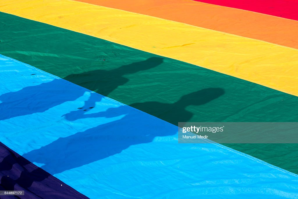 View of a shadow of a couple holding hands during a Gay Pride March at San Martin Square on July 02, 2016 in Lima, Peru.