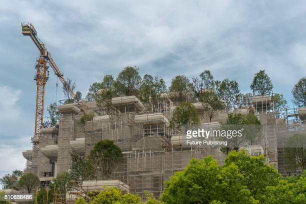 View of a shopping mall under construction featuring about 400 terraces and 1,000 open-air platforms for greenery on July 07, 2017 in Shanghai,...
