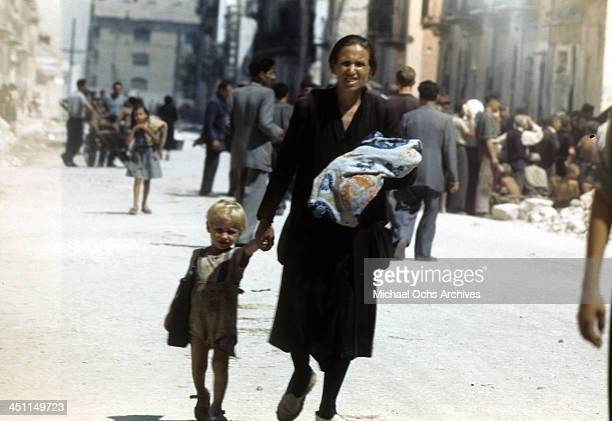 A view of a Sicilian mother and her children after the Allied force invasion of Sicily called Operation Husky during the World War II in Palermo...