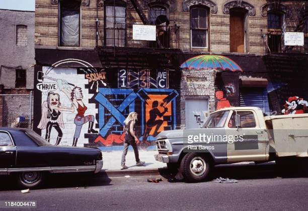 View of a sidewalk mural on a bricked-over building, at 21 and 23 Avenue C in the Lower East Side neighborhood, New York, New York, 1990.