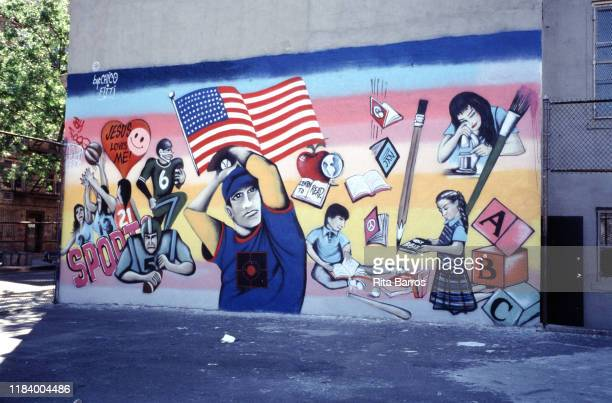 View of a sidewalk mural which features a series school activities, New York, New York, 1990.