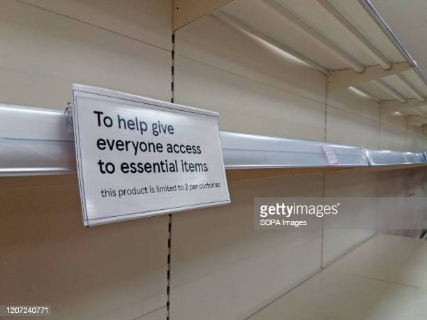 View of a sign limiting customers to only two products per customer at a supermarket amid covid19 Coronavirus fears in London
