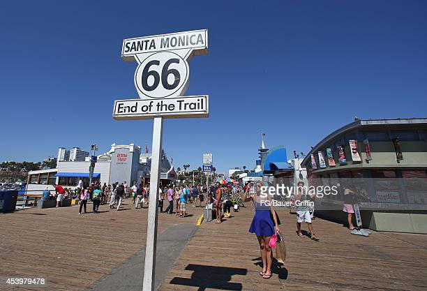 A view of a sign marking the end of Route 66 at the Santa Monica pier in Santa Monica on August 21 2014 in Los Angeles California