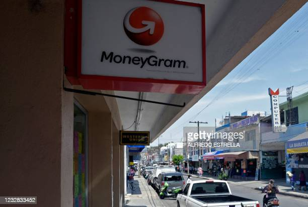 View of a sign of international money transfer system MoneyGram, through which thousands of Mexicans receive remittances from their relatives in the...