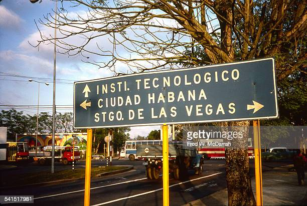 View of a sign on the exit road of Jose Marti International Airport points the way to Havana the Technological Institute and the ward of Santiago de...