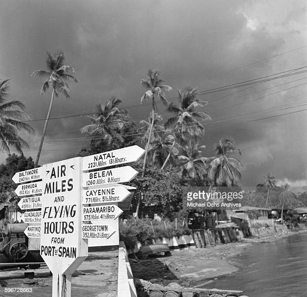 A view of a sign post pointing out air miles and destinations via airplane in Port of Spain Trinidad British West Indies