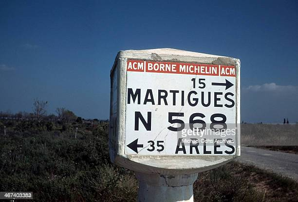 A view of a sign post showing the route to Martigues and Arles France in AixenProvence France