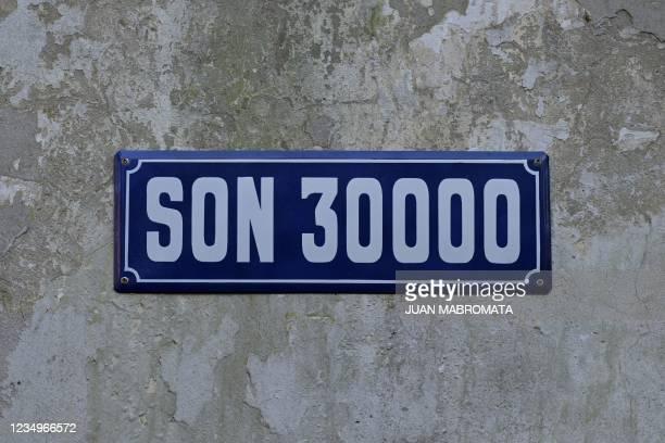 View of a sign reading 'Are 30.000' appointing the new name of a street at the former Army's Mechanics' School which was used as a torture center...
