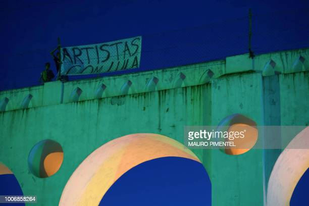 View of a sign reading 'Artists with Lula' during the 'Lula Livre' Music Festival in support of imprisoned former Brazilian President Luiz Inacio...