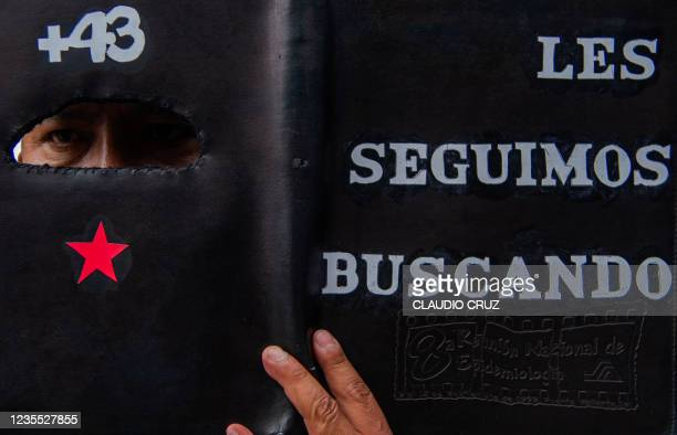 View of a sign reading We keep looking for them during a protest in Mexico City on September 26 to mark seven years of the disappearance of 43...