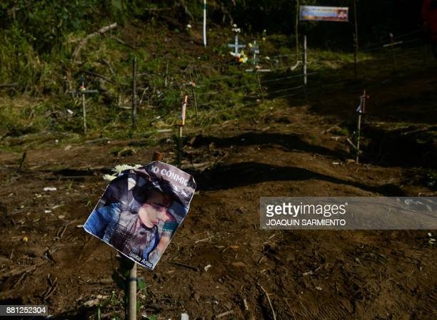 View of a sign with an image of Silsa Arias one of the Bolivian crew member of Lamia flight 2933 at the Chapeco Hill following a mass at the spot of...