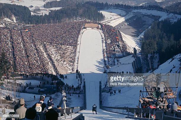 View of a skier competing in the Large hill event of the ski jumping competition at the 1968 Winter Olympic Games at SaintNizierduMoucherotte near...