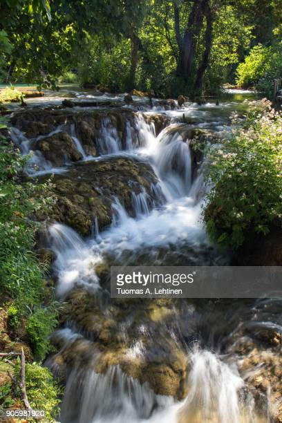 View of a small cascade at the Krka National Park in Croatia on a sunny day.