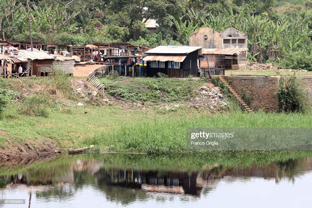 A view of a small market along the river Nyong in the village of Mbalmayo (south Yaounde) on February 19, 2018 in Yaounde, Cameroon. Cameroon is often referred to as 'Africa in miniature' for its geological and cultural diversity. Natural features include beaches, deserts, mountains, rainforests, and savannas.