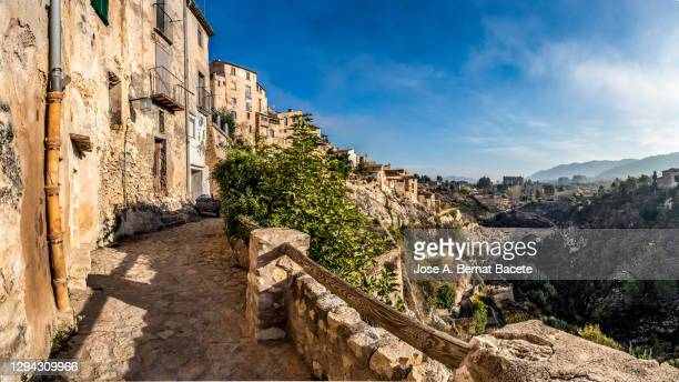 view of a small town with medieval architecture. village of bocairent, spain - valence espagne photos et images de collection