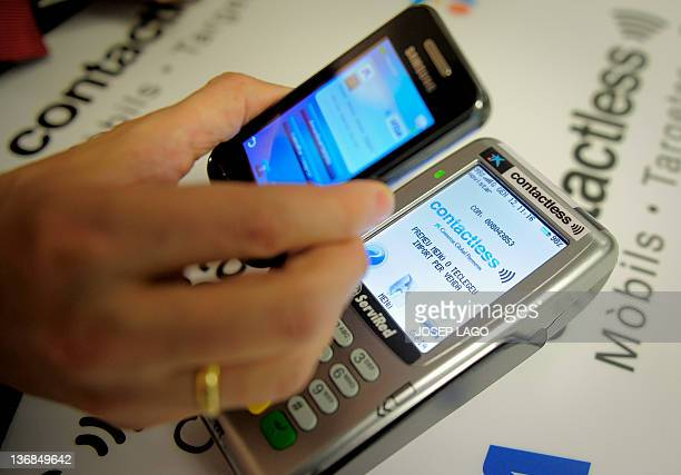 View of a smartphone displaying the 'Contactless' application by Spanish bank La Caixa during it's presentation in Barcelona on January 12 2012...