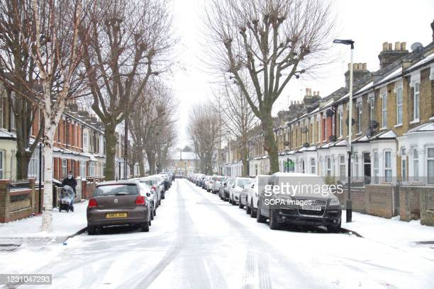 View of a snow covered street in East London following a heavy snowfall caused by Storm Darcy. Heavy snow and ice has brought disruption to parts of...