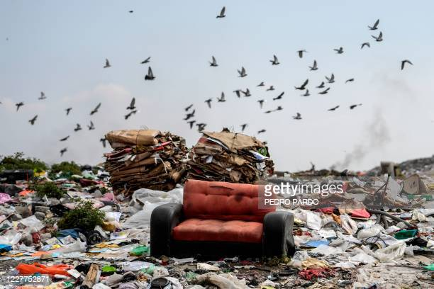 "View of a sofa at the ""Bordo de Xochiaca"" garbage dump in Ciudad Nezahualcoyotl, Mexico State on July 21 amid the new coronavirus pandemic."