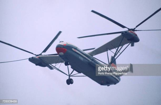 View of a Soviet Union built Mil V12 heavy lift helicopter the largest helicopter ever built pictured in flight above a runway at Le Bourget Airport...