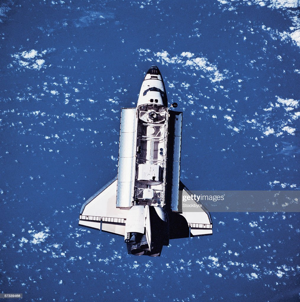 view of a space shuttle climbing into space : Stock Photo