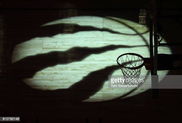 A view of a spotlit logo on the court floor before the start of the Toronto Raptors NBA game against the Utah Jazz at Air Canada Centre on January 26...