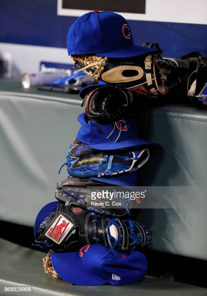 A view of a stack of hats and gloves in the dugout of the Chicago Cubs during the fifth inning against the Atlanta Braves at SunTrust Park on May 16...