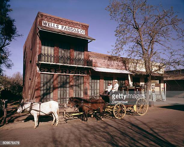 View of a stagecoach in front of a Wells Fargo office in Old West town Columbus California 1960s