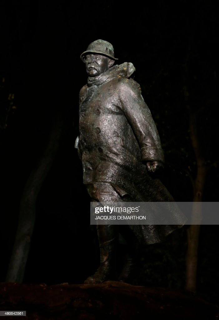 View of a statue of French former Prime Minister Georges Clemenceau by French sculptor Francois Cogne, taken at night on March 25, 2014, in Paris. Clemenceau served as the Prime Minister of France from 1906 to 1909, and again from 1917 to 1920.