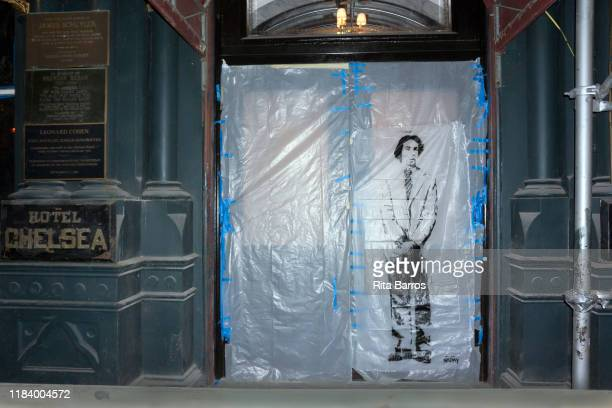 View of a stencil portrait on a plastic sheet covering the front door of the Hotel Chelsea, New York, New York, October 2, 2019.