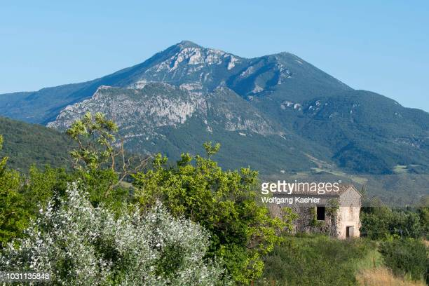 View of a stone house and the mountains from Moustiers-Sainte-Marie, a medieval village in Alpes-de-Haute-Provence region in southern France.