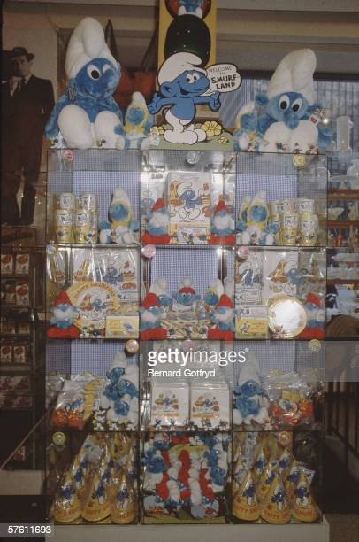 View of a store display of party supplies including paper plates conical hats napkins and cups all decorated with the popular Smurf characters 1980s