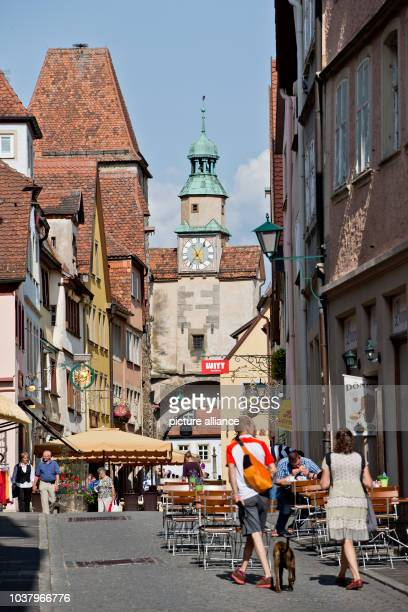 A view of a street and of the Markus Tower is pictured at the old town of Rothenburg ob der Tauber Germany 12 July 2013 Photo Daniel Karmann | usage...
