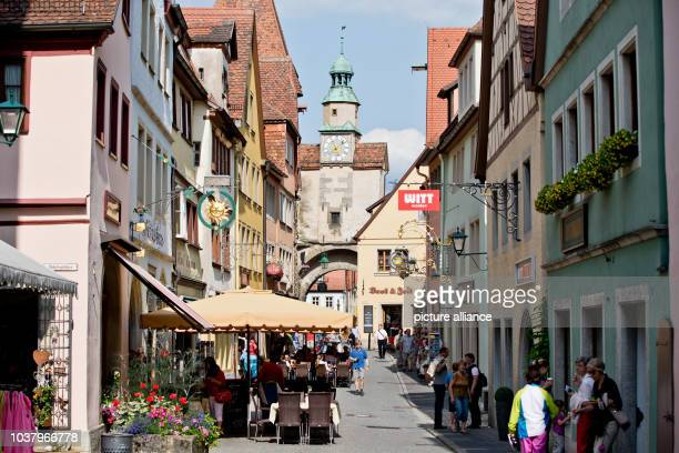 A view of a street and the Markus Tower is pictured at the old town of Rothenburg ob der Tauber Germany 12 July 2013 Photo Daniel Karmann | usage...