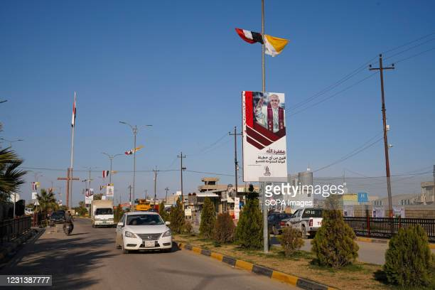 View of a street decorated with Iraqi, Vatican flags and pictures of Pope Francis days before his historic visit to Iraq. The town of Qaraqosh, 30...