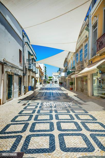view of a street in the city of faro, algarve region, portugal - faro city portugal stock photos and pictures
