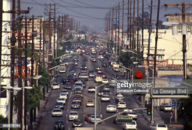 View of a street in West Hollywood with La Cienega Blvd sign in the foreground in circa 1985 in Los Angeles, California.