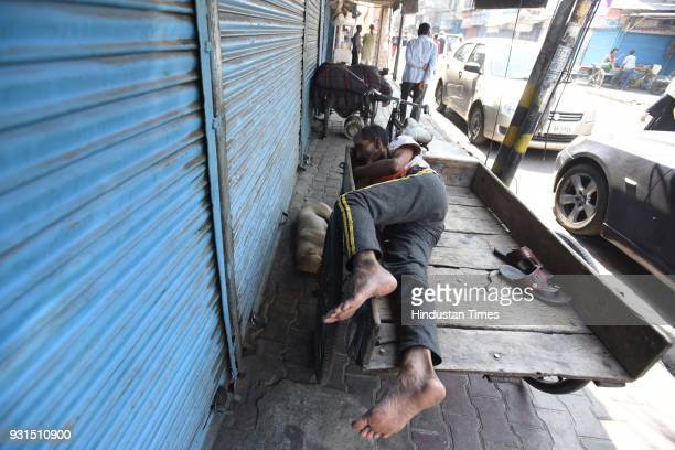 A view of a street of Bara Bazar automobile wholesale market after shops were shut to protest against sealing drive on March 13 2018 in New Delhi...