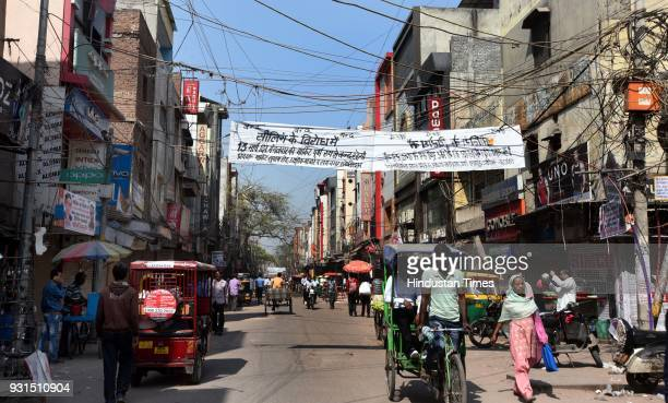 A view of a street of Gandhi Nagar wholesale cloth market after shops were shut to protest against sealing drive on March 13 2018 in New Delhi India...