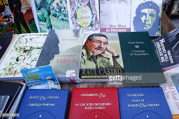 A view of a street stand with Fidel Castro Raul Castro Che Guevara and Cuba related books suvenirs and memorabilia for sale in Havana's city center...