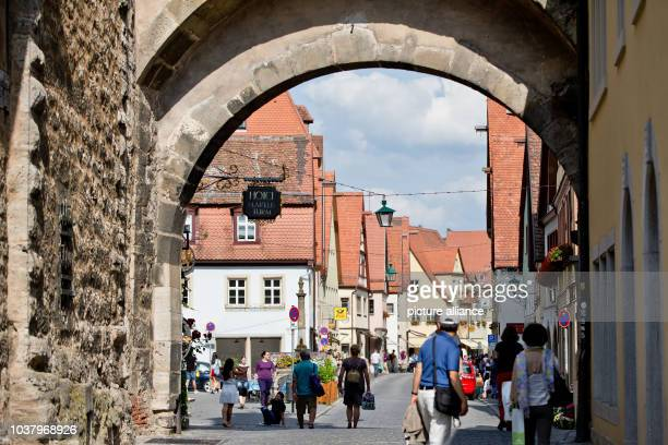 A view of a street through an arch of the Markus Tower is pictured at the old town of Rothenburg ob der Tauber Germany 12 July 2013 Photo Daniel...