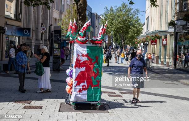 View of a street traders stall selling Wales Football merchandise in support of Wales who are playing the delayed Euros 2020 on June 16, 2021 in...