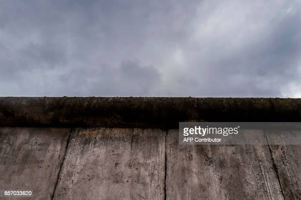 View of a stretch of the Berlin wall at the Bernauerstrasse wall memorial on October 3, 2017. Germans celebrate the Day of German Unity on October 3,...