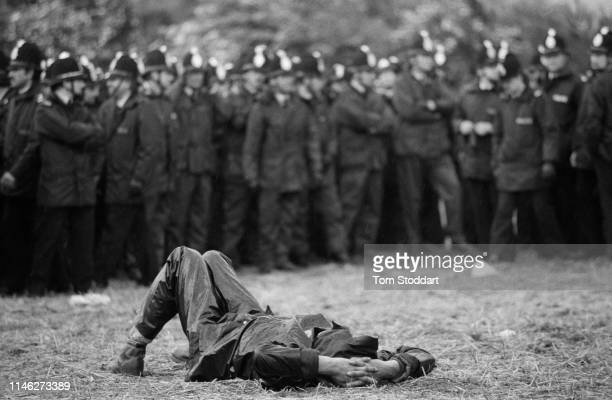 View of a striking miner as he lays on the ground in front of a line of police officers near the Orgreave coking plant Orgreave Yorkshire England May...