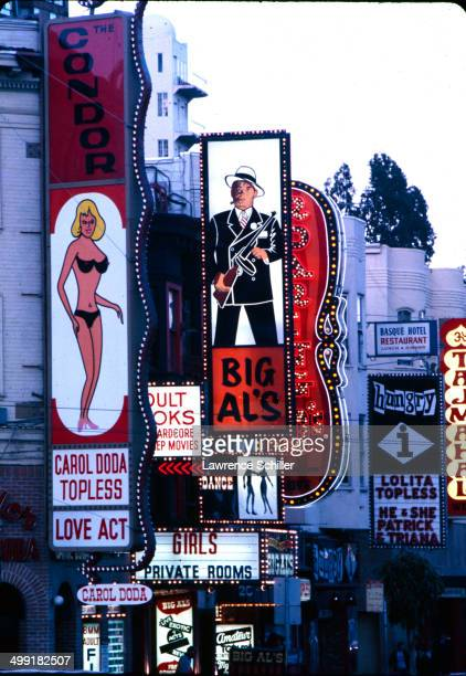 View of a strip of pornography shops and theatres on Broadway Street looking west from the intersection of Columbus Avenue in the Telegraph Hill...