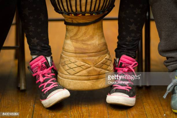 View of a student's feet under a djembe during a drum circle workshop Rockland County New York June 9 2016