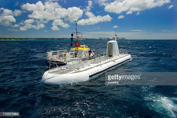 view of a submarine on top of water with blue sky and clouds - submarine stock pictures, royalty-free photos & images