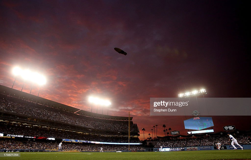 A view of a sunset over the game between the Colorado Rockies and the Los Angeles Dodgers at Dodger Stadium on July 11, 2013 in Los Angeles, California.