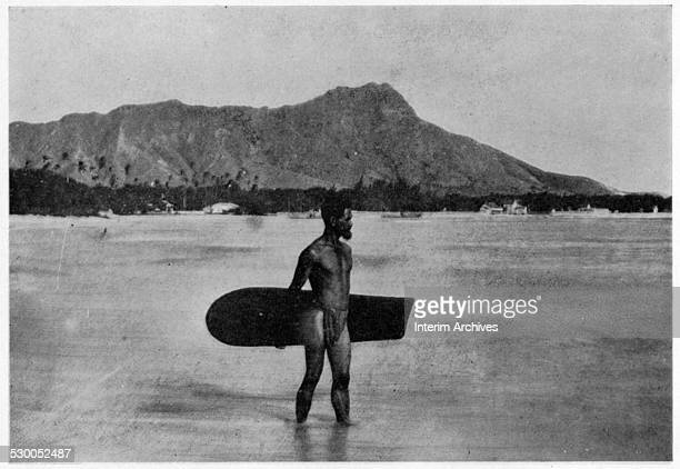 View of a surf rider, from the Hawaiian islands, with Diamond Head in the distance, late nineteenth century. From the photo book 'Scenes in the...