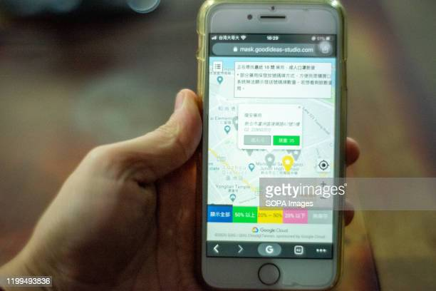 View of a Taiwanese new system app on a smartphone to find the closest pharmacies to buy face masks in New Taipei. In response to the pneumonia...